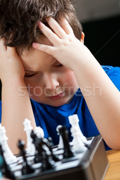 Boy playing chess Stock photo © Talanis