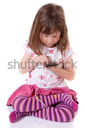 Dziewczyna słuchanie muzyki cute dziewczynka mp3 player Zdjęcia stock © Talanis