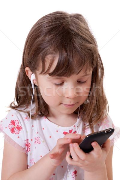 Menina ouvir música bonitinho little girl mp3 player Foto stock © Talanis
