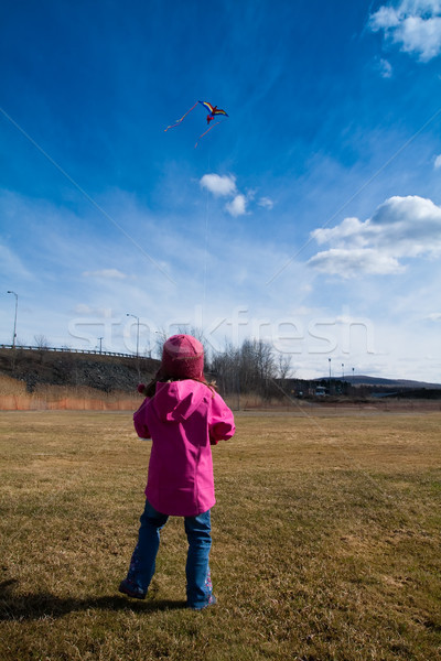 Girl playing with a kite Stock photo © Talanis