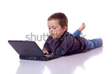 Cute boy with a laptop Stock photo © Talanis