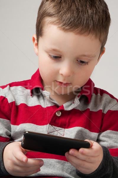 Junge spielen Videospiel cute wenig halten Stock foto © Talanis