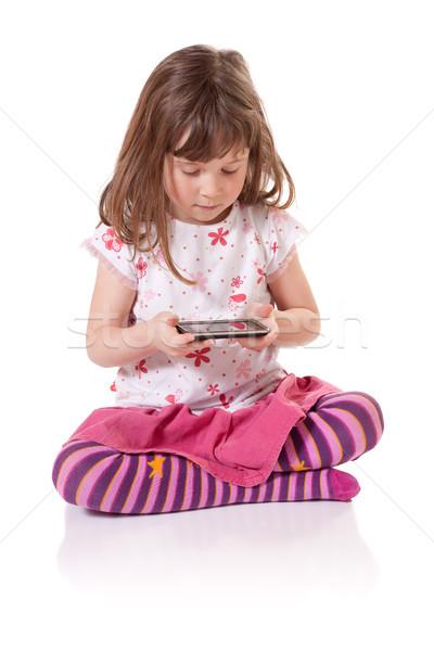 девушки играет видеоигра Cute девочку Сток-фото © Talanis
