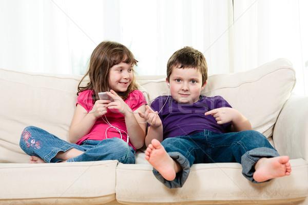 детей сидят диване музыку мальчика Сток-фото © Talanis