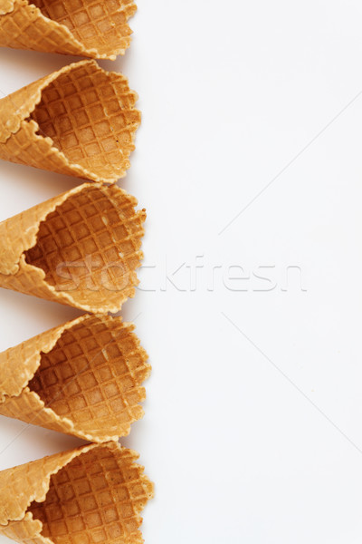 Several waffle cones lined in tower, smile, or even row, top vie Stock photo © TanaCh