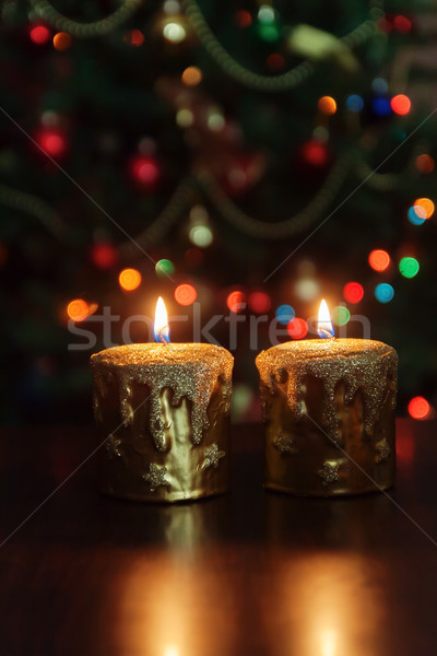 Christmas candle in front of a Christmas tree with sparkling lig Stock photo © TanaCh