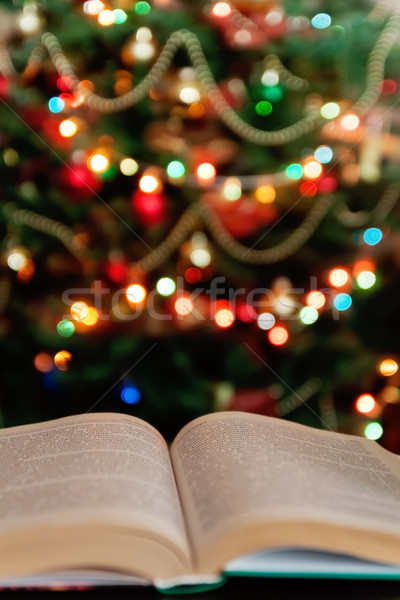 Christmas and bible with blurred candles light background Stock photo © TanaCh