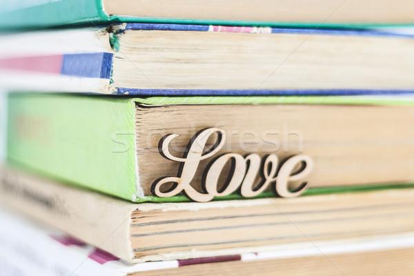 Oude boeken houten woord liefde Stockfoto © TanaCh