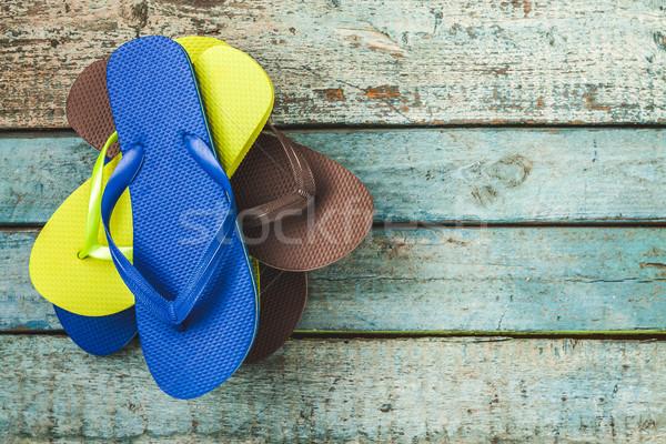 Boglya néhány tarka gumi papucs kék Stock fotó © TanaCh