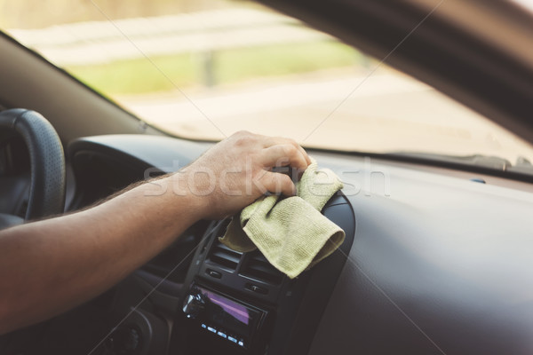A man's hand wipes a carpet with a rag in a retro tint Stock photo © TanaCh