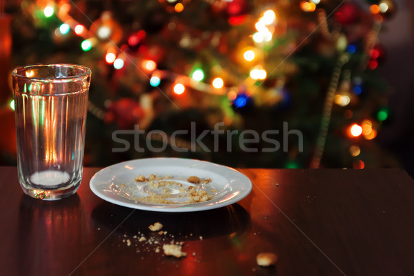 empty glass from milk and crumbs from cookies for Santa Claus un Stock photo © TanaCh