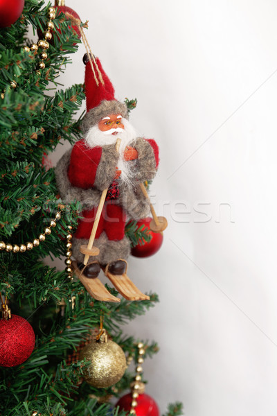 Christmas tree with toys and Santa Claus isolated on white backg Stock photo © TanaCh