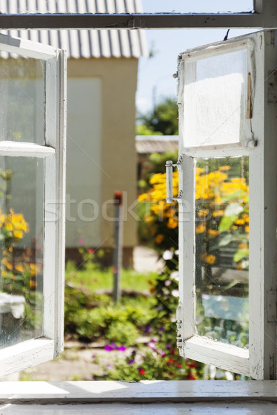 View from an old rural window in a sunny summer courtyard Stock photo © TanaCh