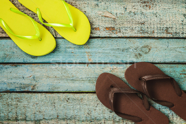 Several pairs of multi-colored rubber flip-flops exhibited in a  Stock photo © TanaCh