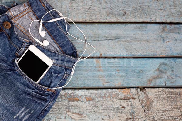 ストックフォト: タッチ · ヘッドホン · ジーンズ · ポケット · 青 · 木製