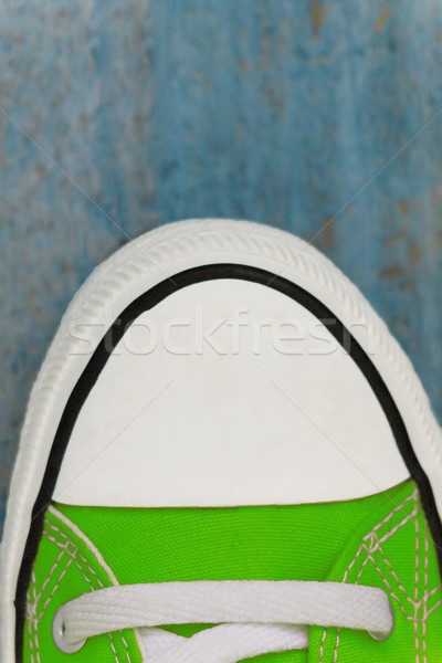 Stock photo: etro sneaker sock, close-up, on a blue wooden background