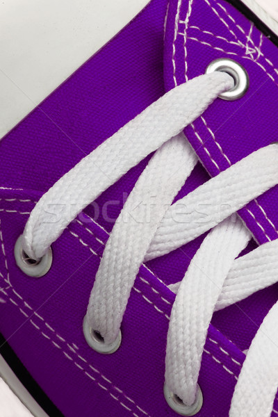Lacing on a retro sneaker, close-up, on a blue wooden background Stock photo © TanaCh