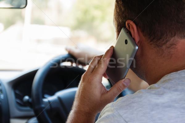 Stok fotoğraf: Adam · konuşma · cep · telefonu · sürücü · araba · telefon