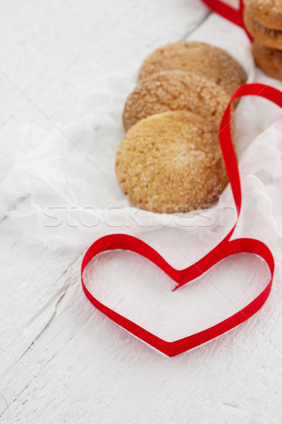 cookies, milk bottle on a white wooden background, and the heart Stock photo © TanaCh