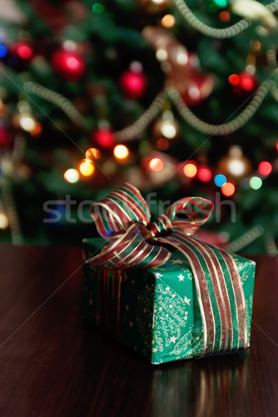 Gifts under the Christmas tree lights background Stock photo © TanaCh
