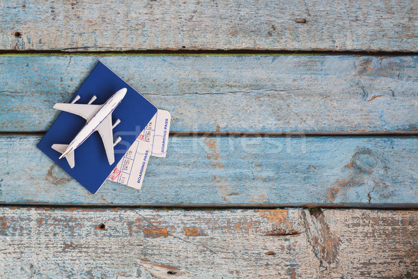 airplane on a passport with air tickets, close-up, on a wooden b Stock photo © TanaCh