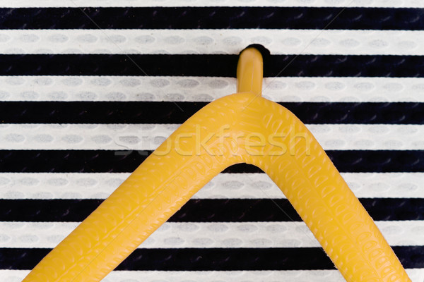 Close-up rubber colored flip-flops, webbed for fingers, coarse t Stock photo © TanaCh