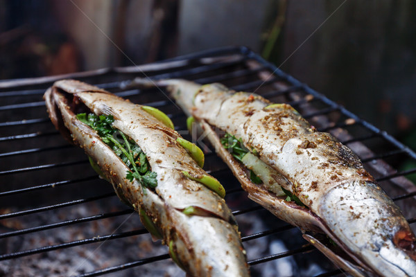 Stock photo: Grilled fish with spices on fire close up. Grilling fish  dorado