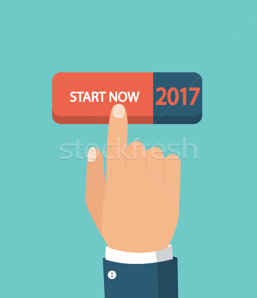 Commencer up début main poussant bouton Photo stock © tandaV
