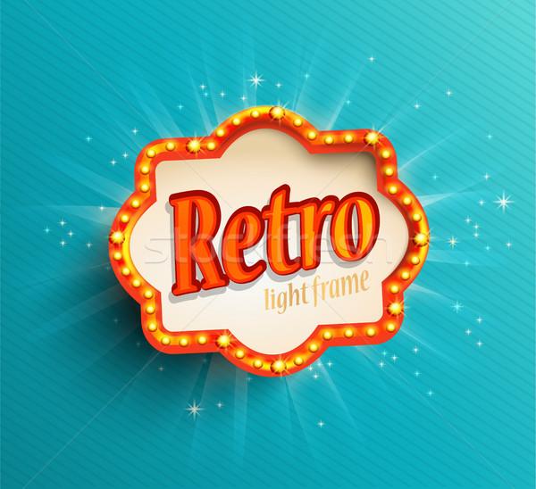 Shining retro light frame on blue background. Stock photo © tandaV