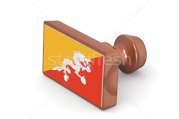 Wooden stamp with Bhutan flag Stock photo © tang90246