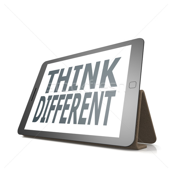 Tablet with think different word Stock photo © tang90246