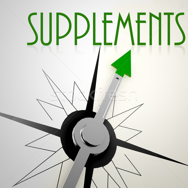 Supplements on green compass Stock photo © tang90246