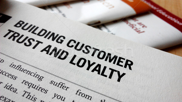 Buiding customer trust and loyalty word on a book Stock photo © tang90246