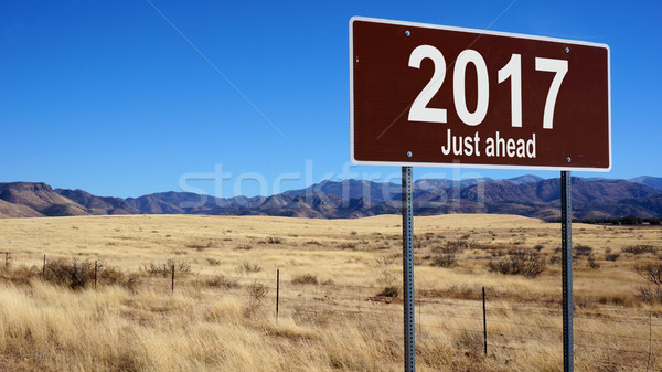 2017 Just Ahead brown road sign Stock photo © tang90246