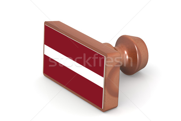 Wooden stamp with Latvia flag Stock photo © tang90246