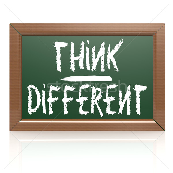 Think Different written with chalk on blackboard Stock photo © tang90246