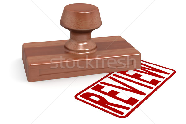 Wooden stamp review with red text Stock photo © tang90246