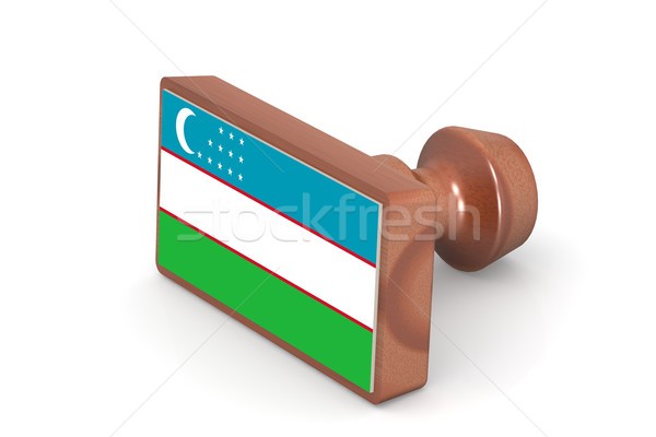 Wooden stamp with Uzbekistan flag Stock photo © tang90246
