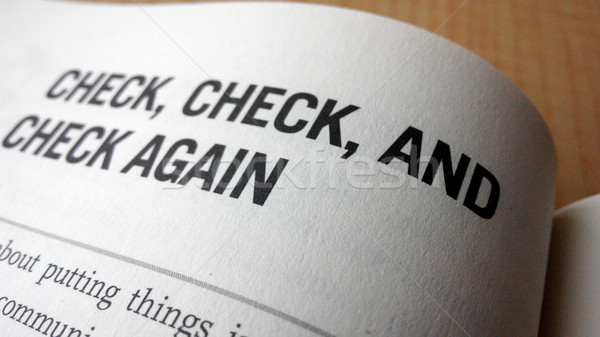 Check again word on a book Stock photo © tang90246