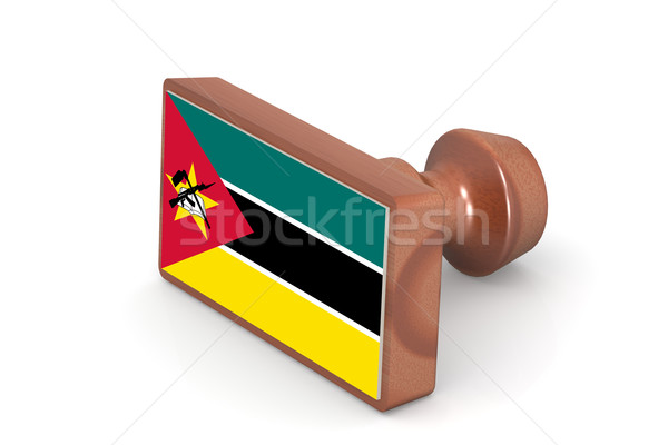 Wooden stamp with Mozambique flag Stock photo © tang90246