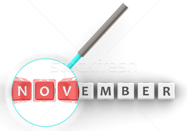November puzzle with magnifying glass  Stock photo © tang90246