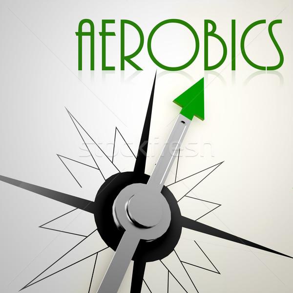Aerobics on green compass Stock photo © tang90246