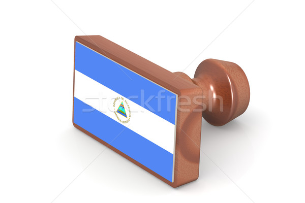 Wooden stamp with Nicaragua flag Stock photo © tang90246