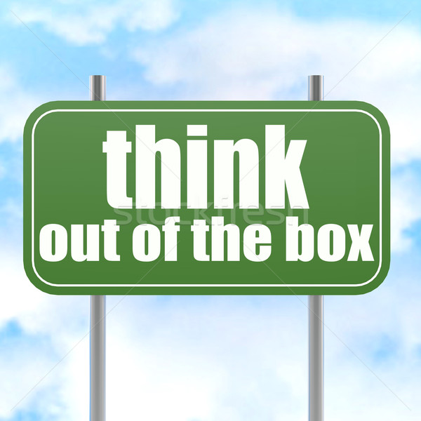 Think out of the box on green road sign Stock photo © tang90246