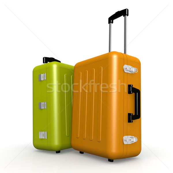 Orange and green luggages stand on the floor Stock photo © tang90246