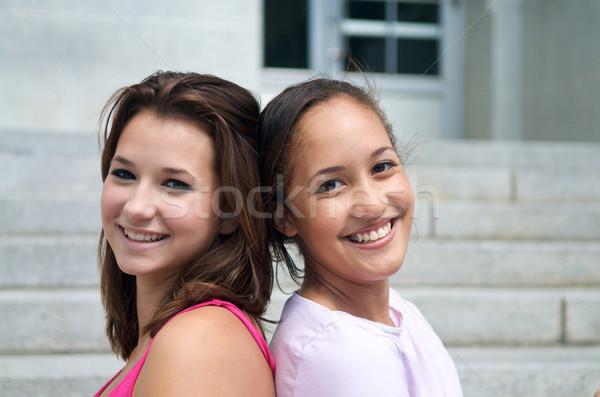 Adolescente meninas amigos sorridente de volta feliz Foto stock © tangducminh