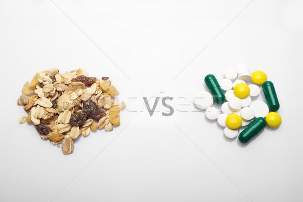 Oatmeal versus medicine Stock photo © tangducminh