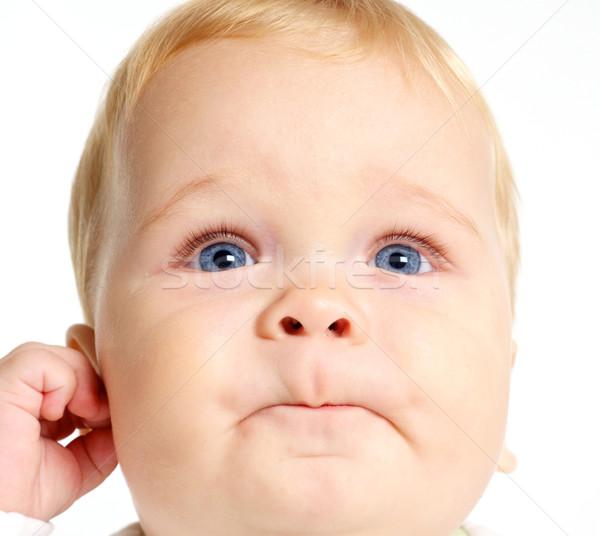 Curioso bebé rubio ojos azules retrato cara Foto stock © tangducminh