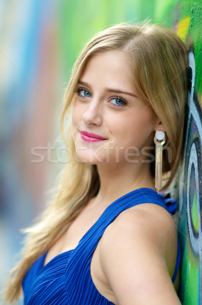 Blond girl on colorful wall   Stock photo © tangducminh