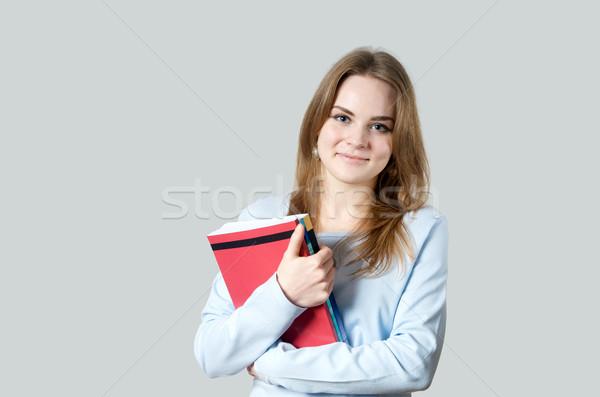 Beautiful girl with textbooks Stock photo © tangducminh